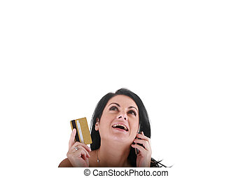 Portrait of smiling young woman using cell phone on white background