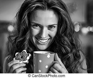 Portrait of smiling young woman with cup of hot chocolate and ch