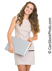 Portrait of smiling young woman with laptop