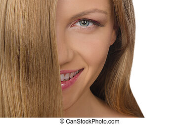 portrait of smiling young woman with straight hair