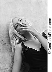 Portrait of smoking beautiful young woman. Black and white