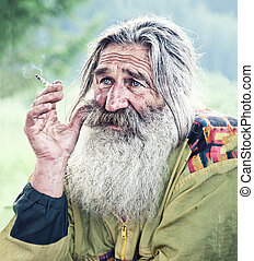 smoking old man - portrait of smoking old man with gray...