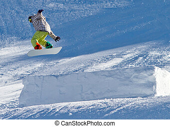 Portrait of snowboarder doing extreme trick