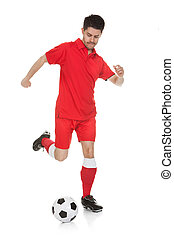 Portrait Of Soccer Player Kicking Ball