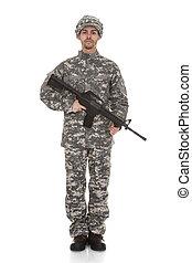 Portrait Of Soldier Holding A Gun