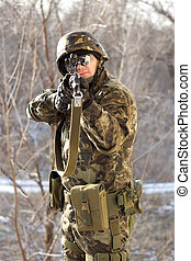 Portrait of soldier with a gun in his hands
