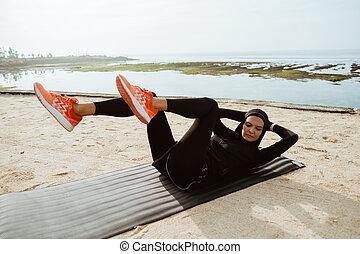 sport muslim woman with hijab sit up - portrait of sport ...