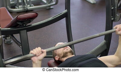 Portrait of sportsmen, who is having an effort in barbell...