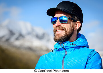 Portrait of sporty bearded man in the mountains