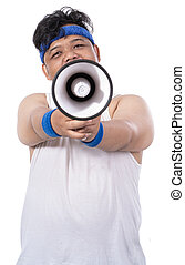 portrait of sporty young man with megaphone