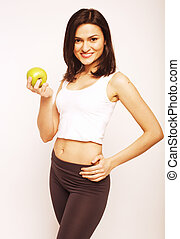 portrait of sporty young woman with green apple