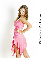 portrait of standing woman wearing pink dress