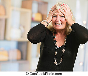 Portrait Of Stressed Mature Woman