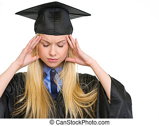 Portrait of stressed young woman in graduation gown