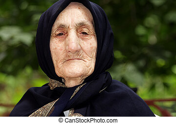 Portrait of strict elderly woman