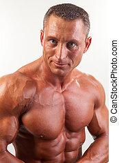Portrait of strong handsome man - studio shot