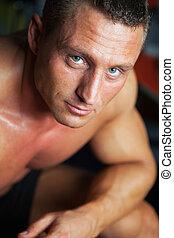 Portrait of strong man - studio shot