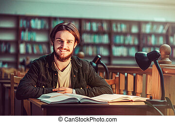 Portrait of Student Man in the Library