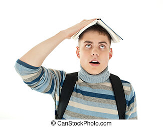 portrait of student with book on the head against a white ...