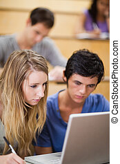 Portrait of students working with a laptop