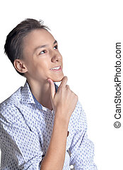 Portrait of studio portrait of smiling teenage boy on white background