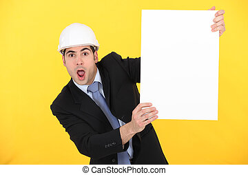 portrait of stunned architect holding board