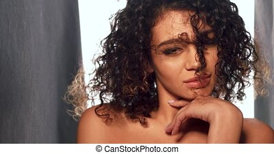 Portrait of stunning swarthy woman. Side view image in...