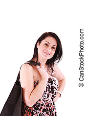 portrait of stunning young woman carrying shopping bag against white background