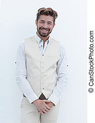 Portrait of stylish man standing near the wall with crossed...