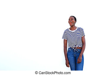 stylish young african woman laughing on white background and looking away