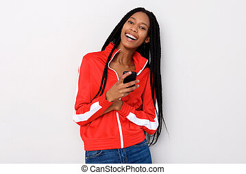 stylish young african woman with mobile phone standing against white background