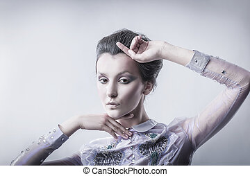 portrait of stylish young woman with day makeup.