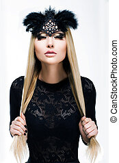 Portrait of Stylized Woman Blonde in Black Carnival Mask with Feathers. Holiday