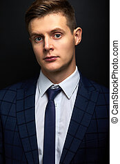 portrait of sublime rich well-off man in suit isolated on black background. male in classic wear has own business. success concept