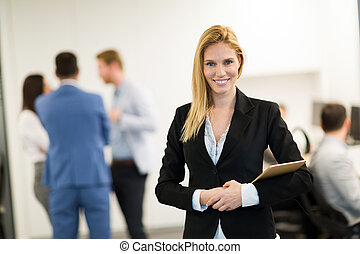 Portrait of successful beautiful businesswoman in office