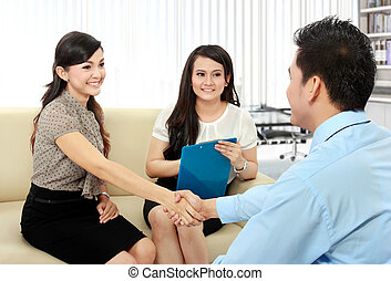 business colleagues shaking hands after interview