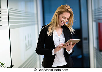 Portrait of successful businesswoman holding digital tablet
