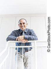 Portrait of successful happy businessman in office