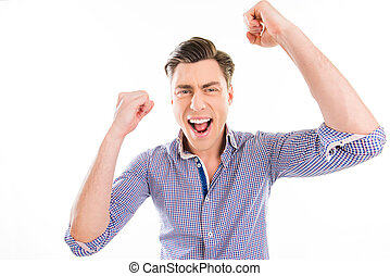 Portrait of successful happy man achieving his goal with raised hands