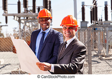 industrial managers holding blueprint