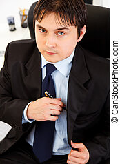 Portrait of successful young business man at office