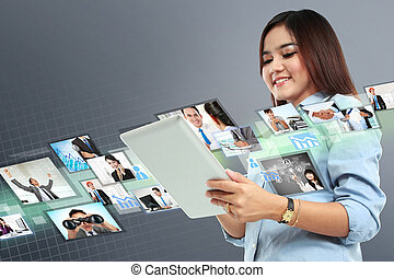 Portrait of successful young woman with tablet
