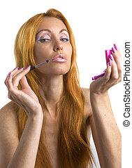 Portrait of sunburnt blonde, doing make-up
