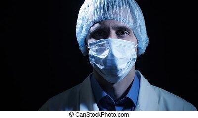 Portrait of surgeon at the dark room