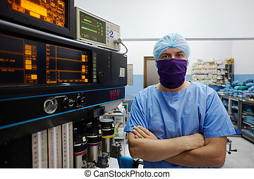 Portrait of surgeon looking at camera in clinic operation...