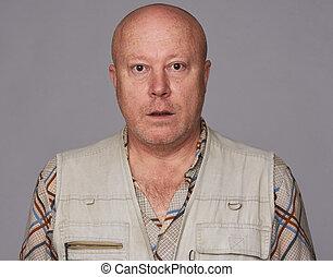 surprised bald senior man isolated