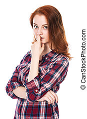Portrait of surprised beautiful young red-haired girl looking at the camera