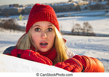portrait of surprised woman with open mouth, winter
