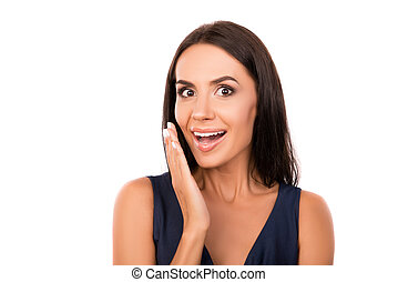 Portrait of surprised young woman on white background