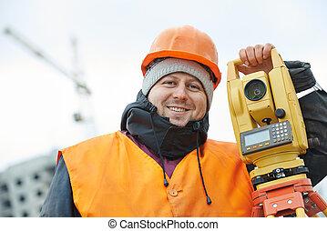 Portrait of surveyor worker with theodolite